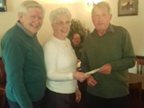 Terry and Rita from the Hospice Volunteer section receiving the cheque from your Chairman Derek Turton